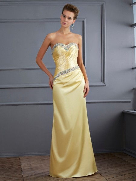 Trumpet/Mermaid Yellow Elastic Woven Satin Floor-Length Dresses with Beading