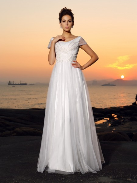 A-Line/Princess Ivory Tulle Floor-Length Wedding Dresses with Beading
